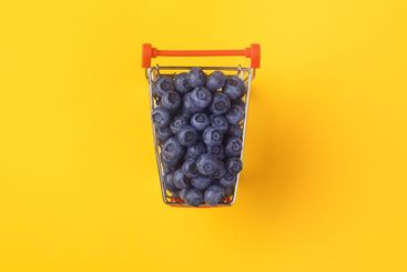 Shopping cart filled with blueberries