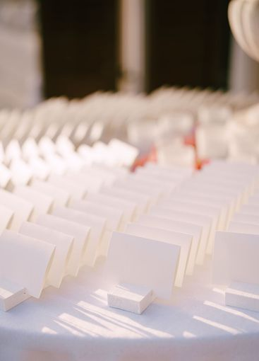 White cards on the table. Wedding seating cards. Wedding...