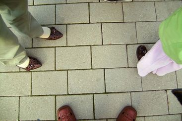 Feet in shoes on stone floor