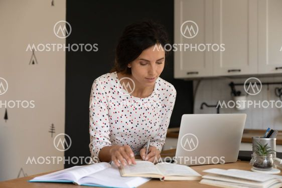 Female student busy studying online from home