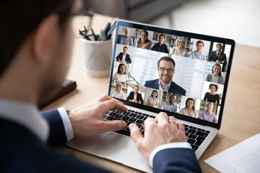 Back view of employee have online web conference with...