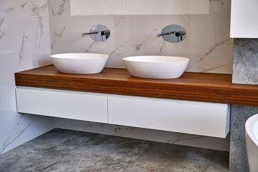 Luxury floating bathroom vanity. Stylish interior of...
