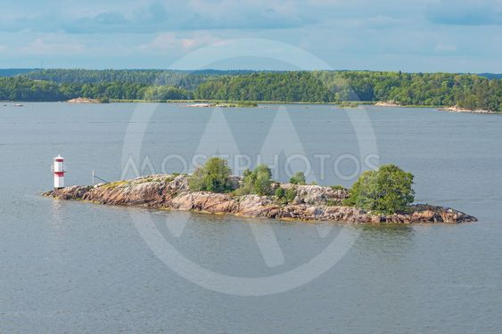 View of a small island with a white beacon in the swedish...