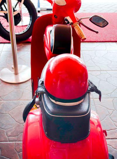 Italian old moped Vespa with helmet