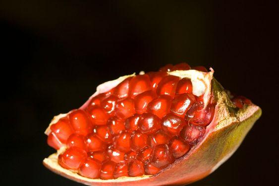 Open Pomegranate over black