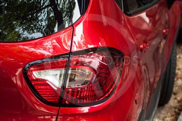 rear light on red Renault captur parked in the street