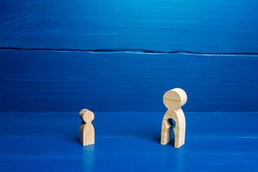 Wooden figurines of a mother with a void and a child....