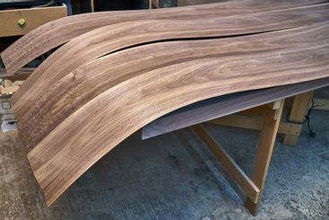Walnut veneer. Wood texture. Woodworking and carpentry...