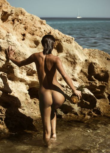 beautiful female model on the beach with naked body at...