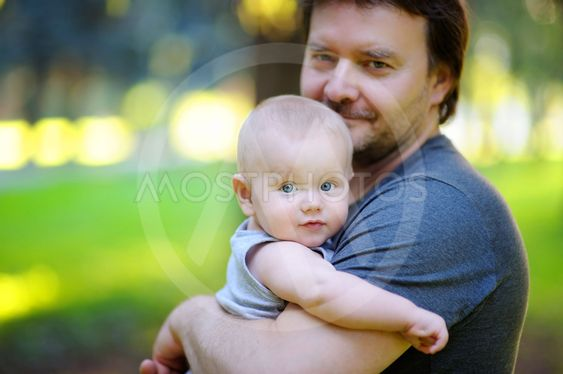 Portrait of father with his little son