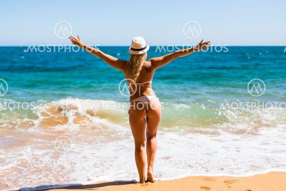 Beautiful woman in white bikini. Young and sporty girl...