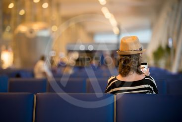 Young traveling woman waiting for transport
