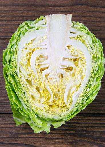 Ripe white cabbage on a wooden table. Top views, close-up
