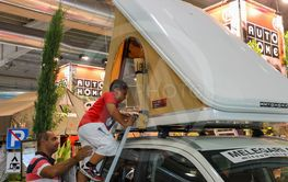 Man and kid testing auto tent in annual exhibition of...