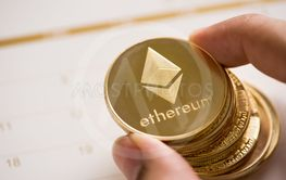 Cryptocurrency golden Ethereum coin  stack on calendar,...