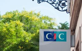 CIC logo on board on agency bank in the street
