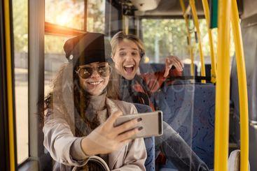 couple taking selfie in public transport