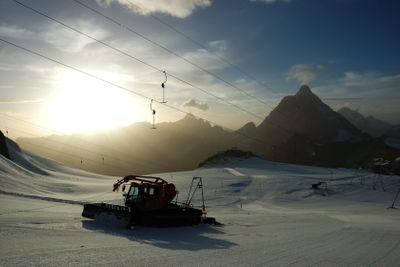 Sunset ski slope snowplow