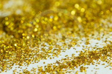 Blur golden background from gold tinsels with bokeh