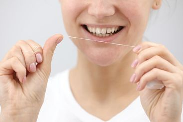 Oral hygiene and health care. Smiling woman use dental...