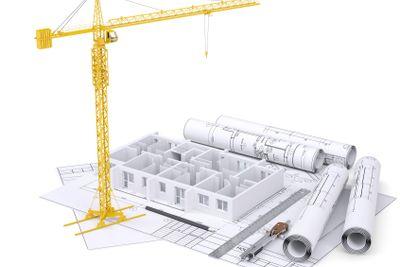 Apartment block under construction, crane, blueprints,...