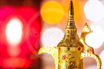 Golden Arabic Coffee pot in colorful illuminated...