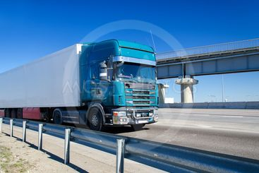 Blue truck driving on highway