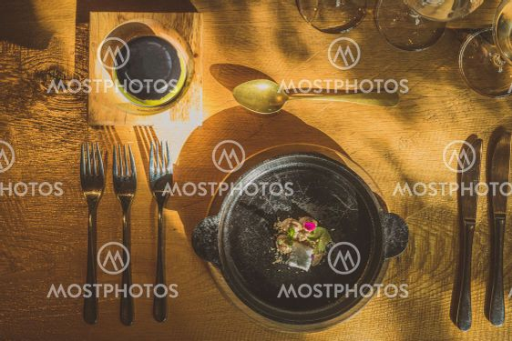 Fancy silverware, crockery, plates and other stuff on a...