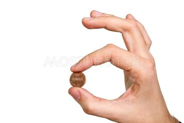 man's hand holding coin