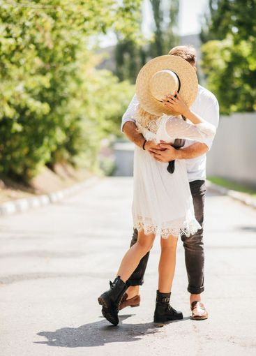 Loving and happy couple kissing outdoors in summer