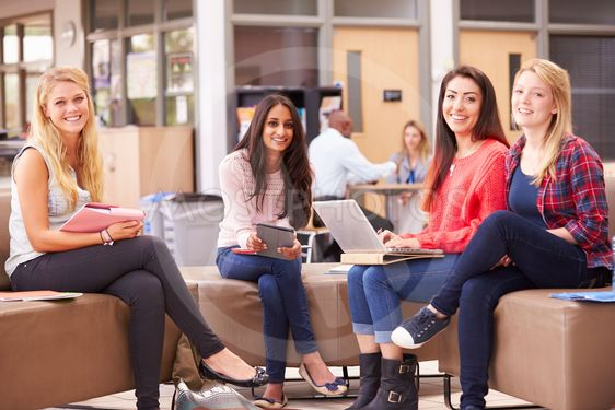 Female College Students Sitting And Talking Together