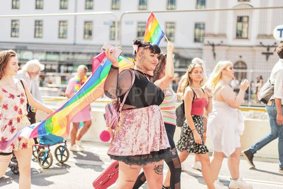 Happy group of friends during the pride parade in Stockholm