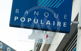 Banque populaire logo on bank agency facade in the street