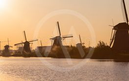 Line of Romantic and Traditional Dutch Windmills in...