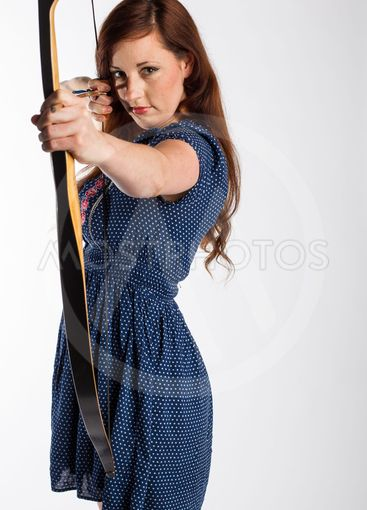 Woman with Red Hair Takes Aim with Arrow