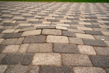 incorrectly laid paving slabs. bumps in road.