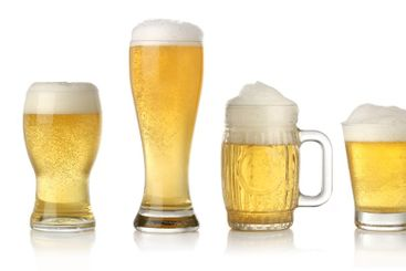 Different glasses of cold lager beer