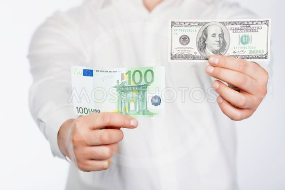 Man with dollar and euro
