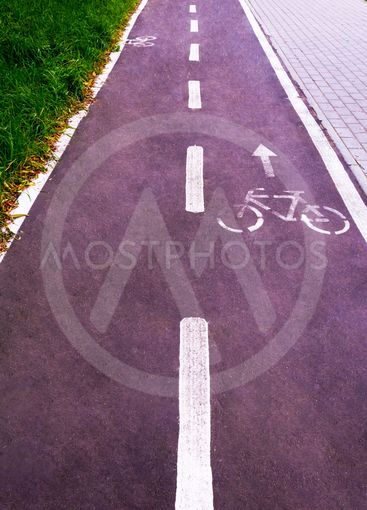 A bicycle path in a public park designed to ensure...