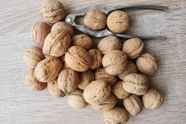 Whole walnuts and nutcracker