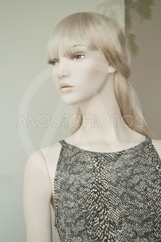 blond mannequin with dress