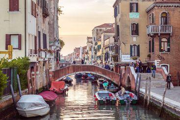 Venice, Italy - October 28, 2016: Streetview with bridge...