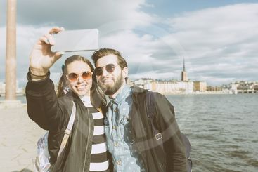 Young hipster couple taking a selfie in Stockholm