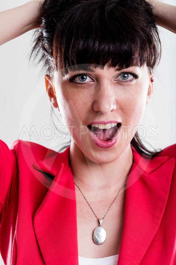 Singing or yelling woman with hands in hair