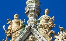 Marble statues on top of the Basilica and Cathedral of...