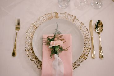 Wedding dinner table reception. Gold plate under white,...