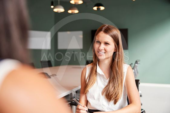 Businesswoman Interviewing Female Candidate At Graduate...