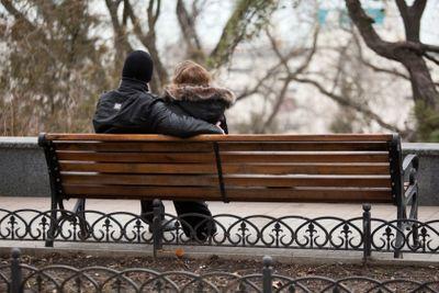 Ukrainian Couple Sitting on a Park Bench in Odessa Ukraine