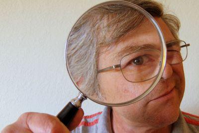 magnifying glass man