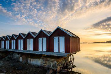 Row of beach huts on the seashore at sunset